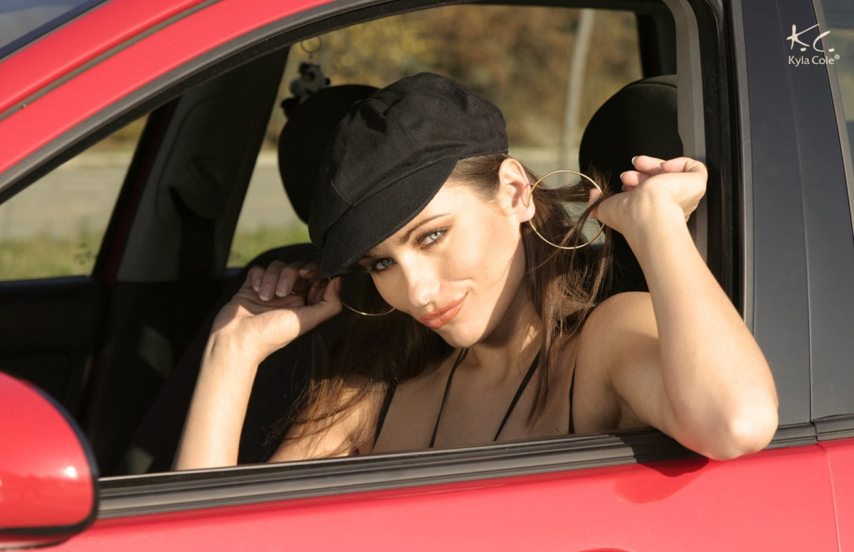 Kyla Cole in Red Ford Focus